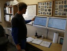 Technican monitors wind turbines - SCADA Solutions case study